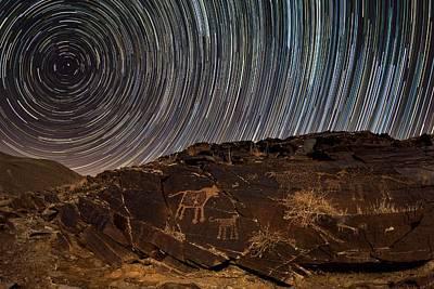 Star Trails Over Rock Carvings Art Print by Babak Tafreshi