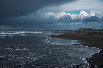Walking In Tide Photograph - Storm Clouds Loom Over The Beach by Robert L. Potts