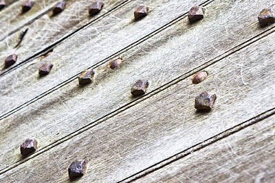 Rivets Photograph - Studded Wooden Surface by Tom Gowanlock