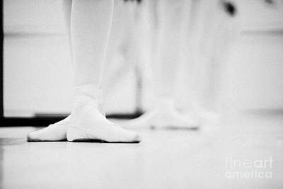 Students With Feet In The Third Position At A Ballet School In The Uk Art Print by Joe Fox