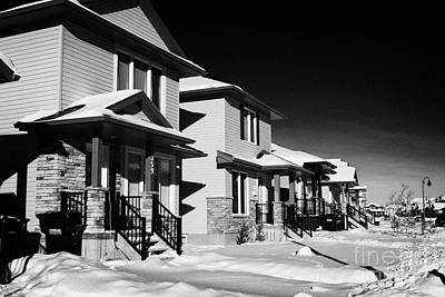 suburbian houses covered in snow during bright crisp winter day Saskatoon Saskatchewan Canada Art Print by Joe Fox