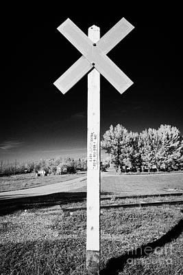 sun bleached railroad crossing sign Saskatchewan Canada Art Print by Joe Fox