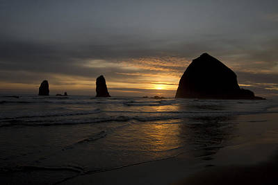 Sunset Over Haystack Rock In Cannon Beach Art Print by David Gn