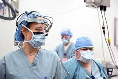 Headlight Photograph - Surgeon Preparing For Surgery by Jim West