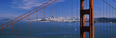 Suspension Bridge With A City Art Print by Panoramic Images