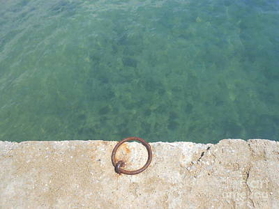 Photograph - Teal Waters And A Rusty Ring In A Dock by Ioanna Papanikolaou
