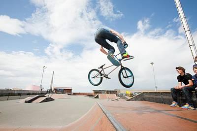 Teenage Boys Perform Aerial Stunts Art Print by Ashley Cooper