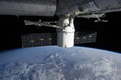Fantasy Royalty-Free and Rights-Managed Images - The Docking Of Spacex Dragon by Stocktrek Images