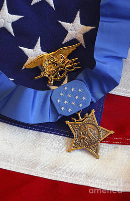Greatness Photograph - The Medal Of Honor Rests On A Flag by Stocktrek Images