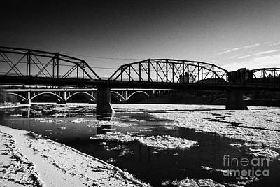 The Old Traffic And Broadway Bridges Over The South Saskatchewan River In Winter Flowing Through Dow Print by Joe Fox