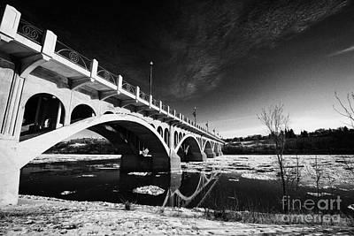 the university bridge over the freezing south saskatchewan river Saskatoon Canada Print by Joe Fox