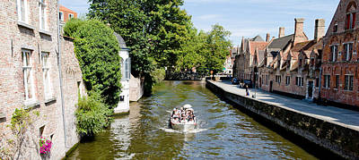 Belgium Photograph - Tourboat In A Canal, Bruges, West by Panoramic Images