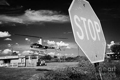 Tourist Light Helicopter Landing Behind Stop Sign Kissimmee Florida Usa Print by Joe Fox