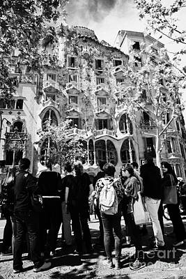tourists tour group outside casa batllo modernisme style building in Barcelona Catalonia Spain Art Print
