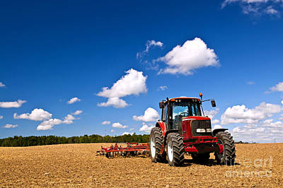 Tractor In Plowed Field Art Print