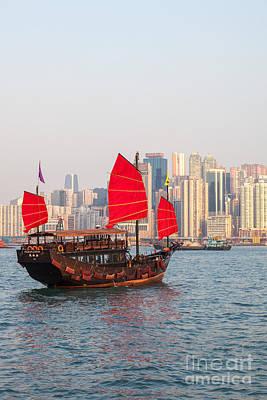 Hong Kong Photograph - Traditional Junk Boat Sailing In Hong Kong Harbor by Matteo Colombo