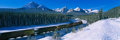 Canadian Rockies Photograph - Train Moving On A Railroad Track by Panoramic Images
