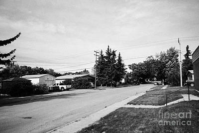 tree lined city street in the town of leader sk Canada Art Print by Joe Fox