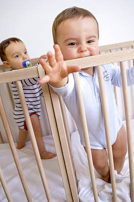 Twin Baby Boys In Their Cots Art Print by Aj Photo