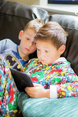 Two Boys Using A Digital Tablet Art Print by Samuel Ashfield