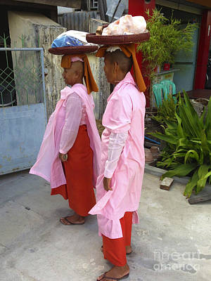 Photograph - Two Buddhist Nuns Collecting Food Donation From Locals 75th Street Mandalay Burma by Ralph A  Ledergerber-Photography