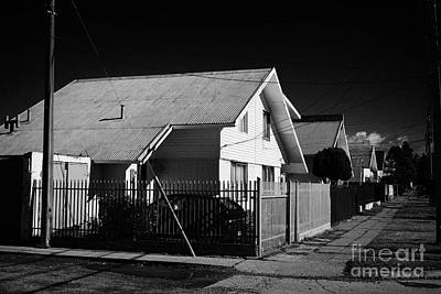 typical chilean construction house with metal tin roof Punta Arenas Chile Print by Joe Fox