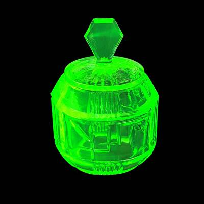 Uranium Glass Fluorescing Art Print by Science Photo Library