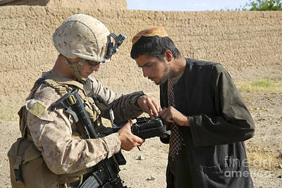 Maps Maps And More Maps - U.s. Marine Utilizes A Biometric by Stocktrek Images