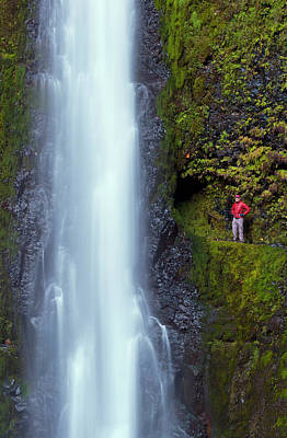 Usa, Oregon A Man In Red Stands Aside Art Print by Gary Luhm