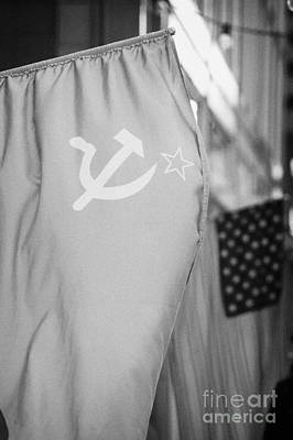 Russian Icon Photograph - Ussr Red Hammer And Sickle Flag Next To Us Stars And Stripes by Joe Fox