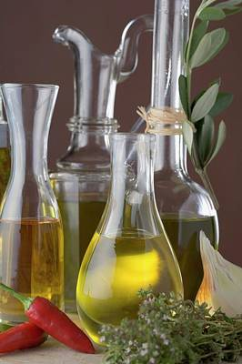 Various Types Of Oil In Carafes And Bottles Art Print