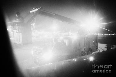 vehicle de-icing aircraft wings at night at Regina airport saskatchewan canada Art Print by Joe Fox