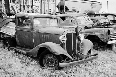 vintage historic chevrolet and ford vehicles in junkyard Saskatchewan Canada Art Print by Joe Fox