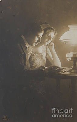 Photograph - Vintage Loving Couple Reading With Oil Lamp by Patricia Hofmeester