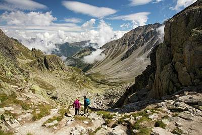 Scree Photograph - Walkers Doing The Tour Du Mont Blanc by Ashley Cooper