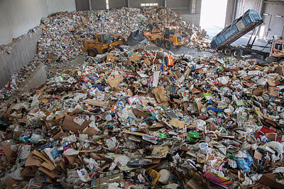 Waste Arriving At A Recycling Centre Print by Peter Menzel
