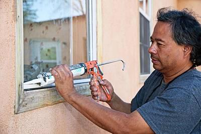 Luis Photograph - Weatherproofing Windows by Jim West