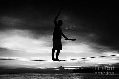 Tightrope Walking Photograph - Will Soto Tighrope Walker Performing At The Evening Sunset Celebrations Mallory Square Key West Flor by Joe Fox