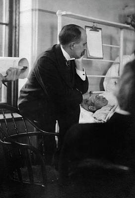 Contemplating Photograph - William Osler Attending A Patient by National Library Of Medicine