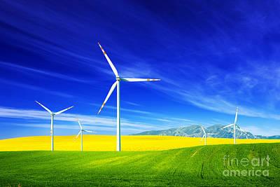 Photograph - Wind Turbines On Spring Field by Michal Bednarek