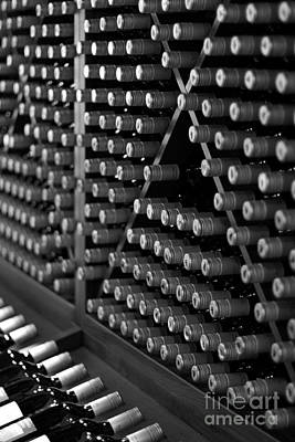 Vino Photograph - Wine Bottles On A Rack At A Winery Near The Vineyards by ELITE IMAGE photography By Chad McDermott