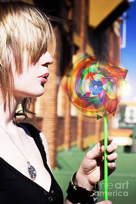 Photograph - Woman Blowing Windmill Toy by Jorgo Photography - Wall Art Gallery