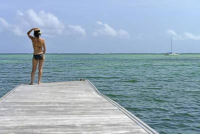 Woman Contemplating Ocean From Pontoon Art Print by Sami Sarkis