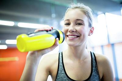 Self-confidence Wall Art - Photograph - Woman Drinking Water In Gym by Science Photo Library