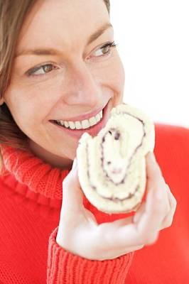 Portraits Photograph - Woman Eating Cake by Ian Hooton