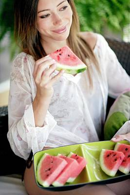 Watermelon Photograph - Woman Eating Watermelon by Ian Hooton/science Photo Library