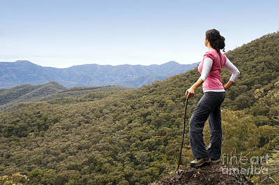 Athletes Royalty-Free and Rights-Managed Images - Woman Hiker in Mountains by Tim Hester