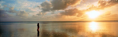 Woman Standing On Sandbar Looking Art Print by Panoramic Images