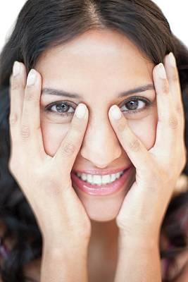 Woman Touching Face Art Print by Ian Hooton