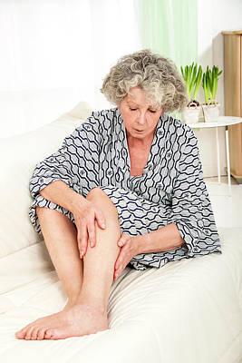 Bathrobe Photograph - Woman Touching Her Legs by Lea Paterson